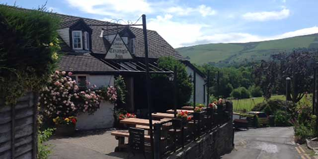 Outside the Triangle Inn looking down to the River Wye with the rolling foothills of the Cambrian Mountains in the background